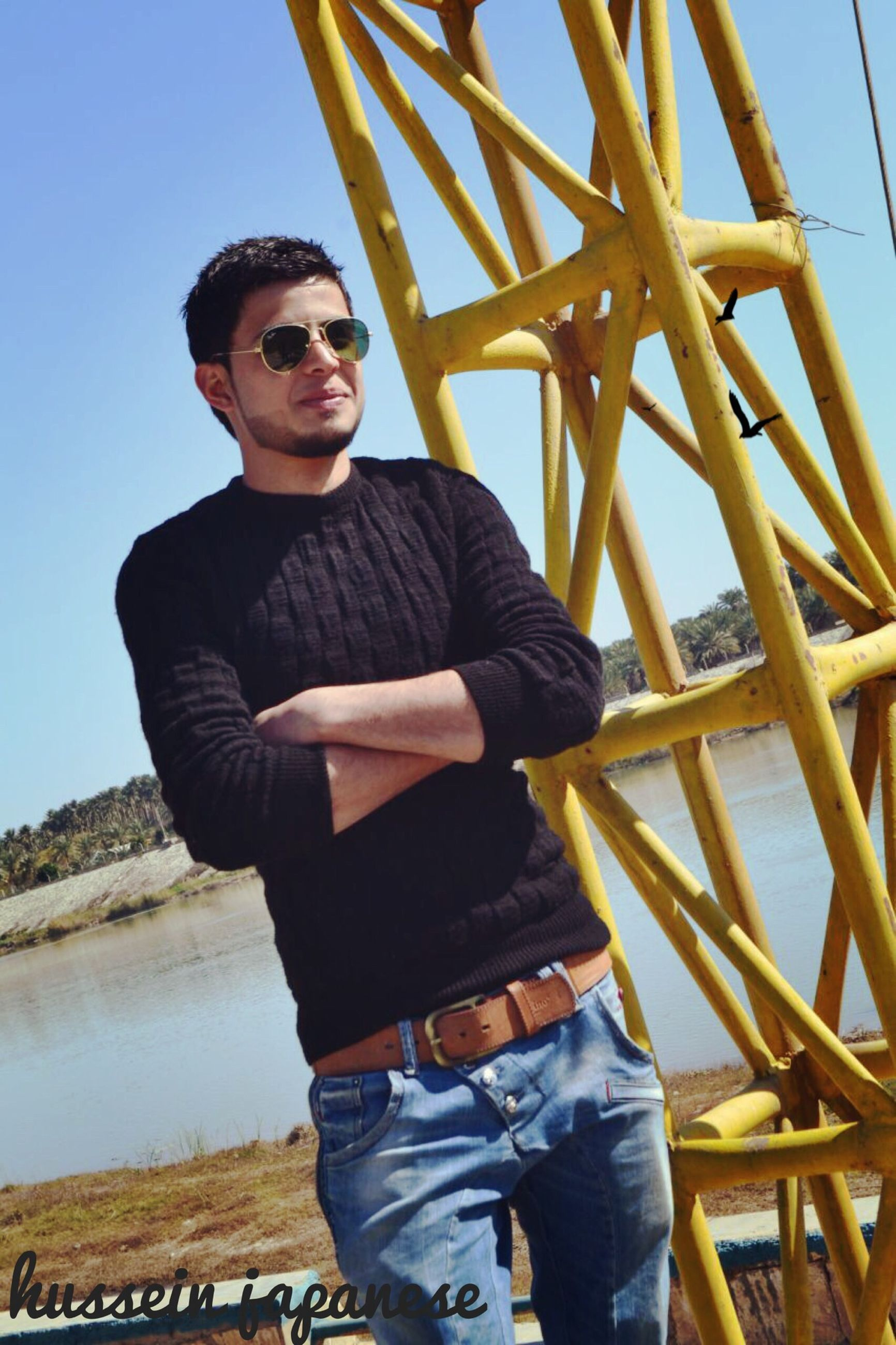 casual clothing, lifestyles, leisure activity, person, standing, young adult, three quarter length, portrait, looking at camera, full length, front view, clear sky, smiling, young men, sky, sitting