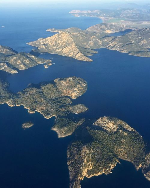 Aereal view at South West part of Turkey with the sea and mountain lanscape before landing at Dslaman Airport Aegean Sea Aereal Photo Aereal View Airplane Blue Earth Green Hills Horizon Island Landing Landscape Mountain Plane View Sea Tourism Tourist Travel