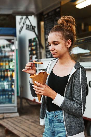 Young woman looking at food