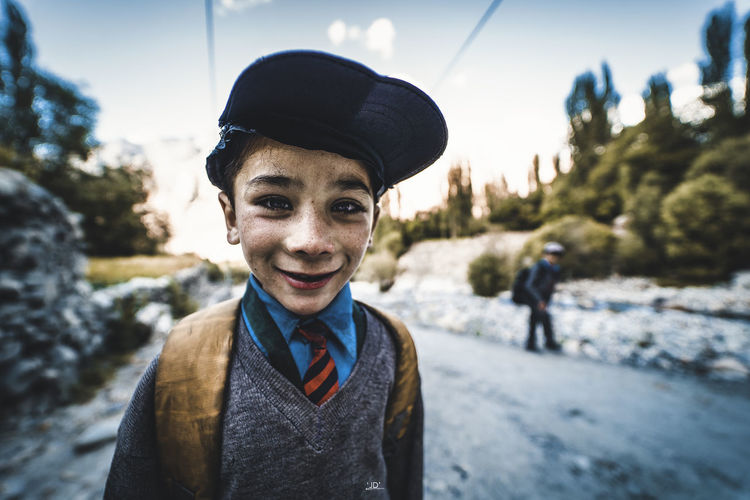 Portrait of smiling boy standing outdoors during winter