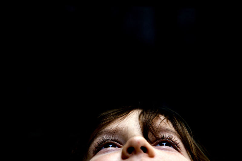 Boy looking up. Black Background Boy Child Childhood Children Only Close-up Copy Space Cropped Eyesight Headshot Human Body Part Human Eye Human Face Looking Up One Person Portrait