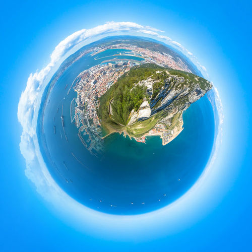 Little planet composition of an aerial view of the top of Gibraltar Rock, located in the Upper Rock Natural Reserve. United Kingdom, South West Europe. Globe concept, ecosystem, earth. Gibraltar Landscape Gibraltar Monkeys Gibraltar Rock Gibraltar And Sea Panorama Aerial View Blue Cloud - Sky Day Landscape Mountain Nature No People Outdoors Physical Geography Planet Planet - Space Planet Earth Satellite View Sea Sky Space Topography