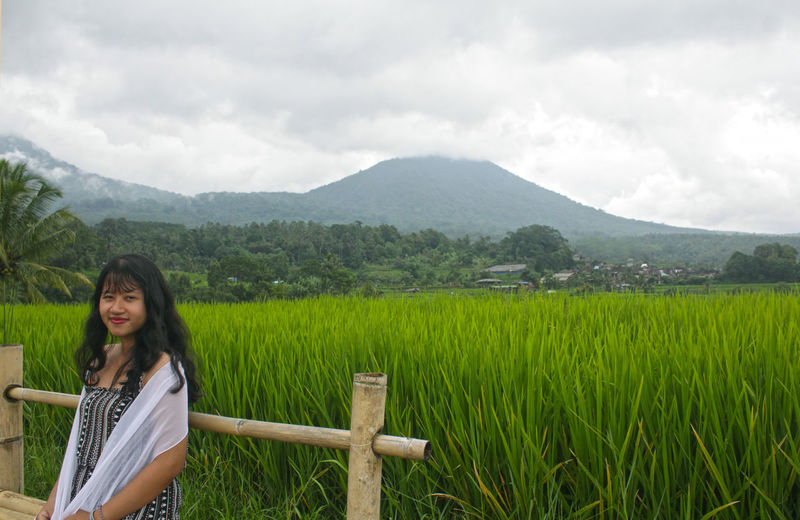 Cloud - Sky One Person Plant Sky Nature Adult Women Land Field Young Adult Day Landscape Outdoors Hairstyle Jatiluwih Rice Terrace Rice Paddy Countryside Looking At View Tranquility Tranquil Scene Rice - Cereal Plant Mountain Range Scenics Terraced Field