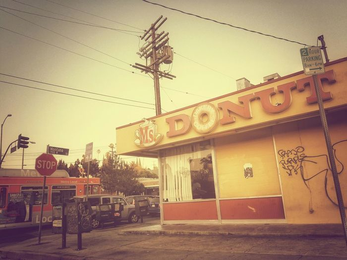 Downtown Architecture Building Structures On The Streets Passenger View Streets Of Los Angeles Dounut Shop Donuts Graffiti Sidewalk Side Metro Power Lines Traffic Stop Sign Street Sign To Live And Die In LA