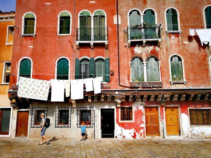 venice Fasada colour of life Venice, Italy Venice #Venice #Venezia #Italy #Italia #Europe Washing Laundry Men Window Architecture Building Exterior Built Structure Building Walking Balcony Residential District The Architect - 2018 EyeEm Awards