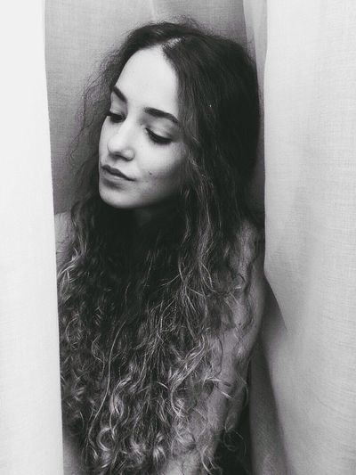 Self Portrait for Let Your Hair Down 💗 That's Me Curly Hair Smile Curls Curly Hair! Long Hair Girl Hello World Blackandwhite BW_photography Selfie ✌ Looking Down Minimalism Curtain White Background No Makeup Contouring Highlighting Face Skin