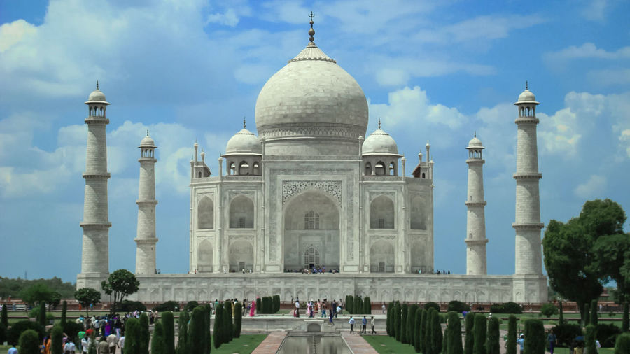 Taj Mahal India Seven Wonders Of The World Taj Mahal Taj Dramatic Sky Monument Heritage Site Mughal Shahjahan Tourist Tourist Attraction  City Water Dome Place Of Worship Sky Architecture Built Structure Cloud - Sky Historic Tomb Marble Memorial Marbled Effect National Monument EyeEmNewHere Visual Creativity