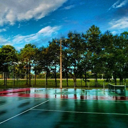 Reflections puddles on the tennis courts Outdoors Tennis Workkout Fitness playing