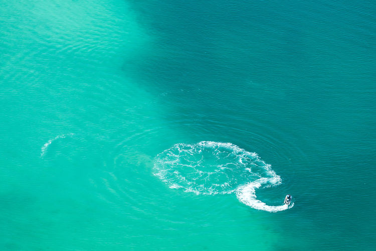 Aerial View Of Boat Moving On Sea