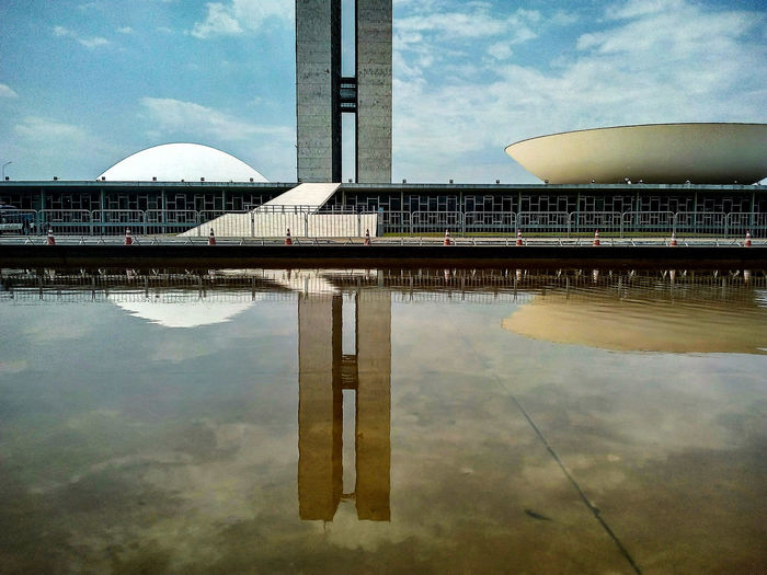 Reflection Water Architecture Built Structure Sky Spirituality Waterfront Standing Water Cloud Building Exterior Place Of Worship Travel Destinations Calm Famous Place Outdoors Cloud - Sky Tourism No People Reflected  Brasilia City Lifestyles City Street