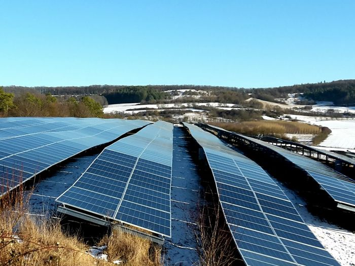 Solar park in winter Solar Energy Solar Panel Environmental Conservation Alternative Energy Environmental Issues Nature Outdoors Day No People Solar Power Station Ground Mounted Solar System Blue Sky Clear Sky Sunlight Snow Winter Copy Space
