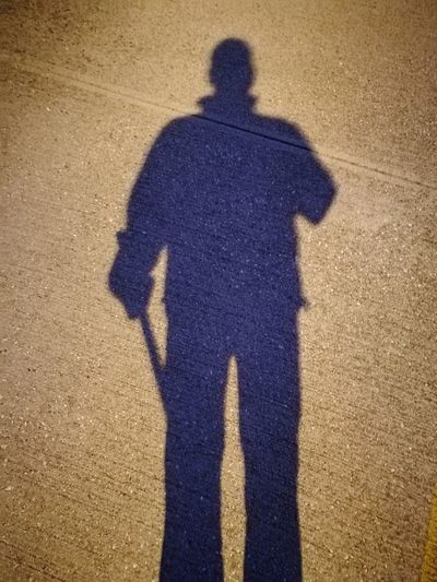 Shadow of man and woman standing in park
