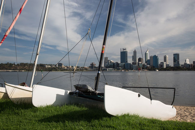 View ower Swan River to Skyline of Perth Australia Perth Australia Skyline Architecture Boat Building Exterior Built Structure City Cloud - Sky Day Mast Mode Of Transport Moored Nature Nautical Vessel No People Outdoors Sailboat Sea Sky Swan River Transportation Water