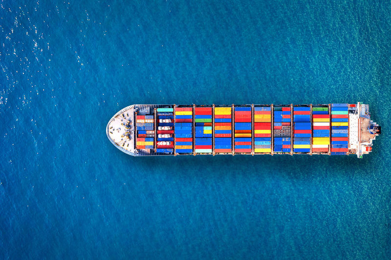 High angle view of multi colored container ship on sea