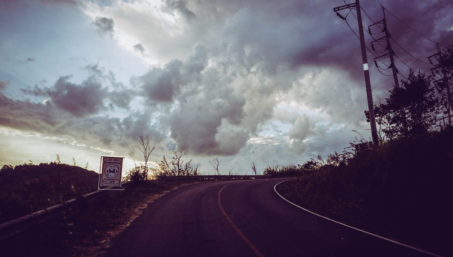 Panoramic view of empty road against sky