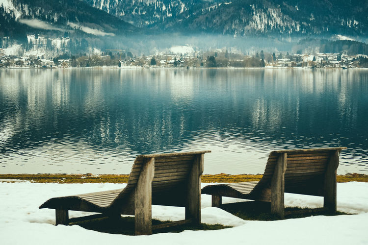 Winter vacation Water Lake Tranquility Tranquil Scene Beauty In Nature Nature Scenics - Nature No People Non-urban Scene Idyllic Reflection Day Wood - Material Outdoors Pier Seat Winter Vacation Vacations Vacation Winter Wonderland Winter Wintertime Relaxing Calmness Calm Sky Absence Beach