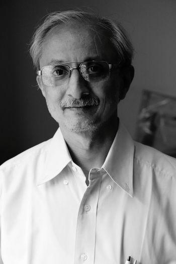 Close-up portrait of mature man wearing eyeglasses