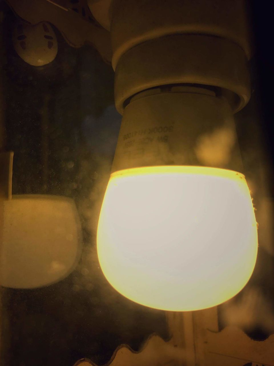 illuminated, lighting equipment, no people, close-up, night, yellow, low angle view, indoors, technology, astronomy
