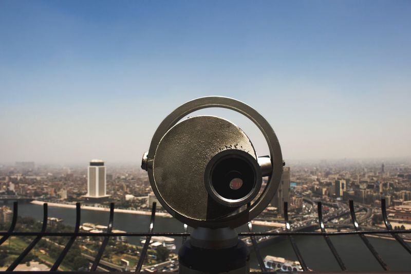 EyeEm Selects Cityscape Coin-operated Binoculars City Architecture Building Exterior Built Structure Clear Sky No People Outdoors Hand-held Telescope Skyscraper Day Sky Technology Close-up