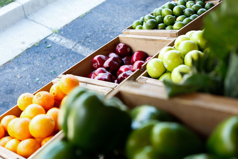 High angle view of various fruits and vegetable for sale at market stall