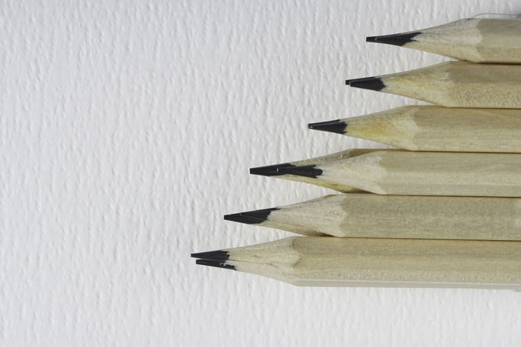 High angle view of pencil on table against wall