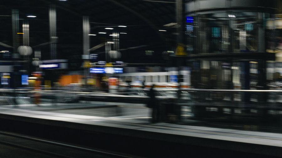 Blurred motion of train at railroad station at night