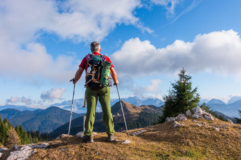 Hiker with backpack is stand on mountain top. Mountain One Person Sky Adventure Hiking Scenics - Nature Mountain Range Leisure Activity Day Nature Beauty In Nature Outdoors Hiking Hiker Senior Adult Top Success Backpack Mature Men Mature Adult Activity Standing Cloud - Sky