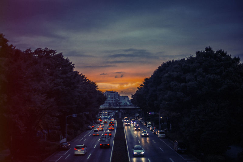High Angle View Of Cars On Two Lane Highway At Sunset
