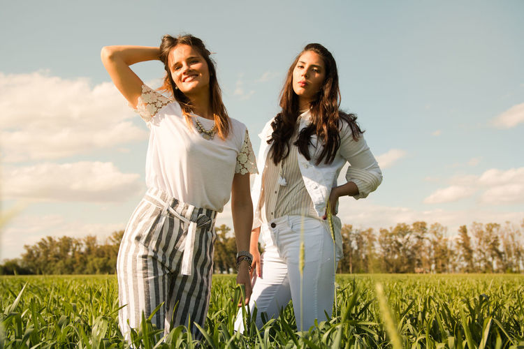 Argentine models Field Plant Sky Land Two People Young Adult Togetherness Women Standing Nature Young Women Three Quarter Length Long Hair Real People Front View Smiling Casual Clothing Bonding Landscape Hairstyle Hair Positive Emotion Outdoors Beautiful Woman Fashion Stories