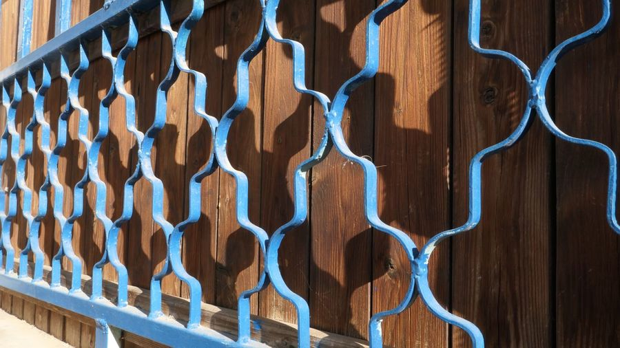 EyeEm Selects Full Frame Wood - Material Pattern Backgrounds Brown No People Close-up Day Fence Wood In A Row Outdoors Side By Side Metal Barrier Design Shape