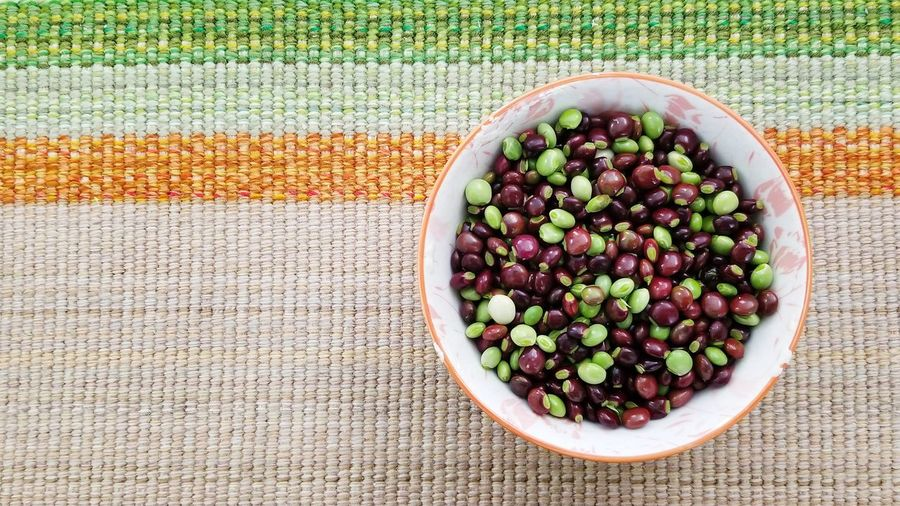 High angle view of pigeon peas in bowl on table