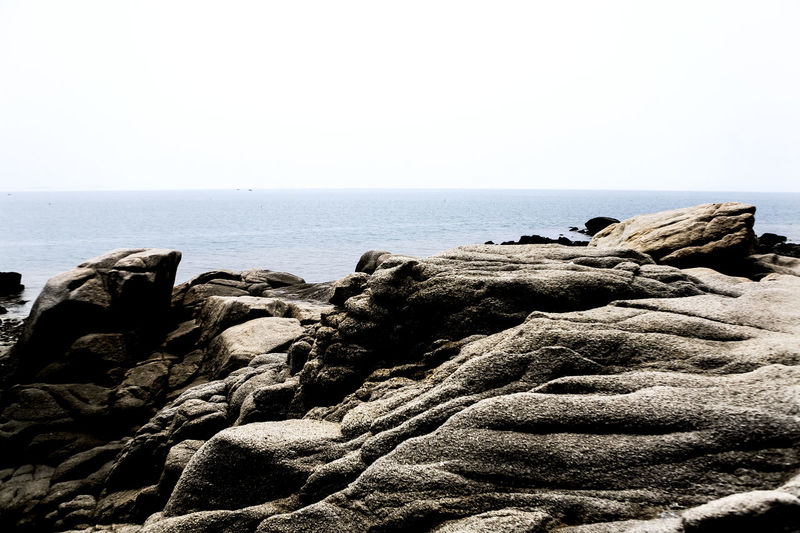 Beach Coast Escapism Geology Horizon Over Water Incidental People Island Jetty Ocean Outdoors Physical Geography Pier Rippled Rock Rock - Object Rough Sea Seaside Shore Stone Stone - Object Vacation Water Youngjong Island