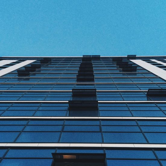 Architecture Built Structure Low Angle View Building Exterior Clear Sky Blue Skyscraper Copy Space Building Glass - Material Tall - High Office Building City Modern Tall Tower Diminishing Perspective Day Outdoors Repetition No People Modern Window City Architecture