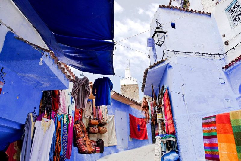 Low Angle View Of Market Stall Amidst Buildings