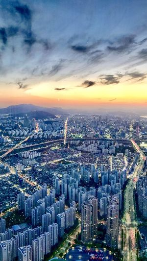 Cityscape Skyscraper Architecture City Building Exterior Crowded Built Structure Modern Sky Downtown District Outdoors Financial District  Sunset Aerial View Cloud - Sky Travel Destinations Urban Skyline Day