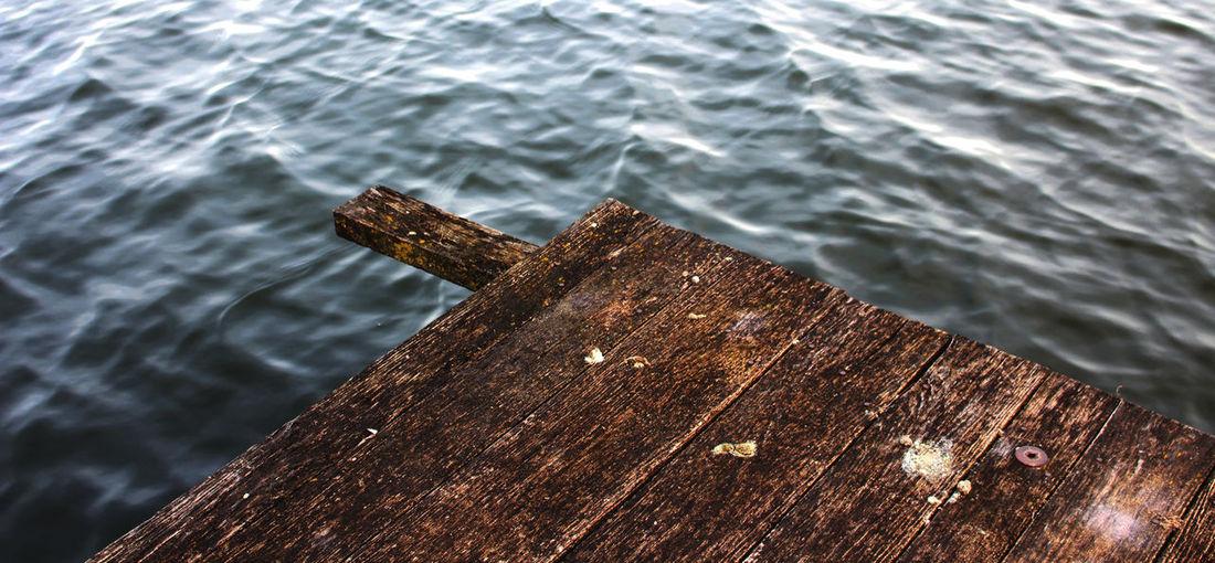 High angle view of pier corner over lake