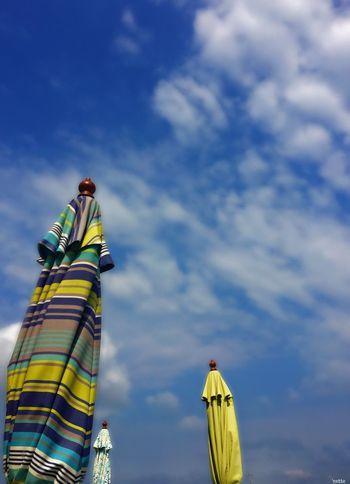 Umbrellas Beachumbrellas Against The Sky Summer Colorful