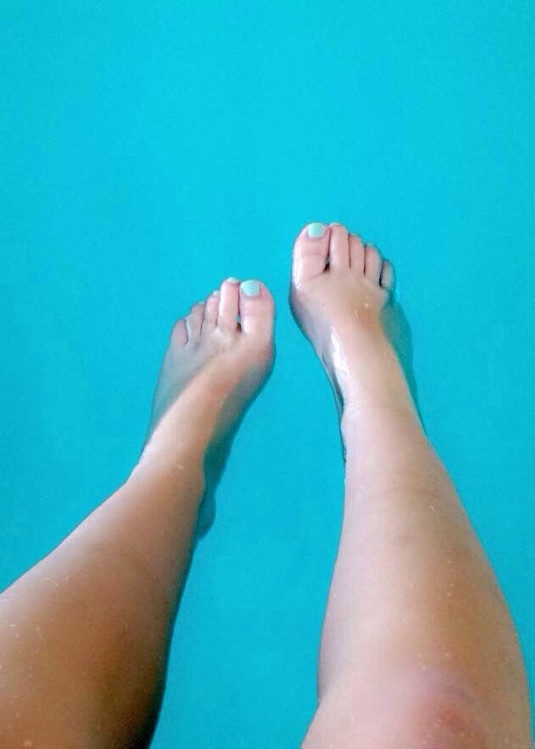 low section, person, personal perspective, barefoot, blue, human foot, lifestyles, part of, leisure activity, swimming pool, nail polish, relaxation, human limb, water, indoors