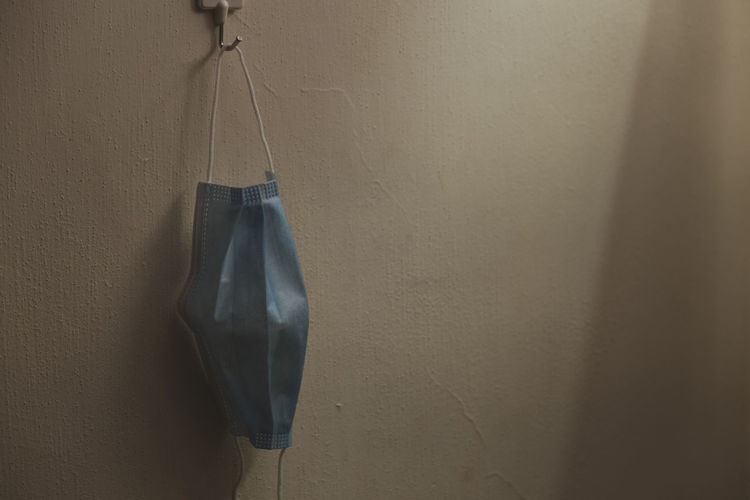 Close-up of clothes hanging on wall at home