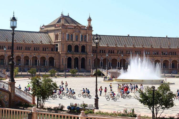 A lot of fun in Plaza de Espana, Sevilla. A group of people with bicycle getting around, others walking over the bridge...! Aechitecture Appreciating This Moment Bridge View Building Built Structure Bycicles City City Life Day Façade Famous Place Feel Good Feel The Journey Fountain Group Of People Original Experiences Outdoors People Plaza De España Riding Bike Tourism Travel Destinations Urban Visit