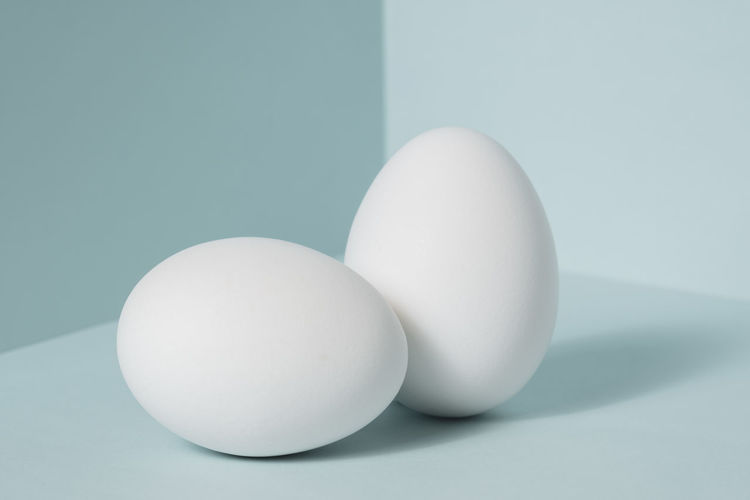 Close-up of white eggs on table