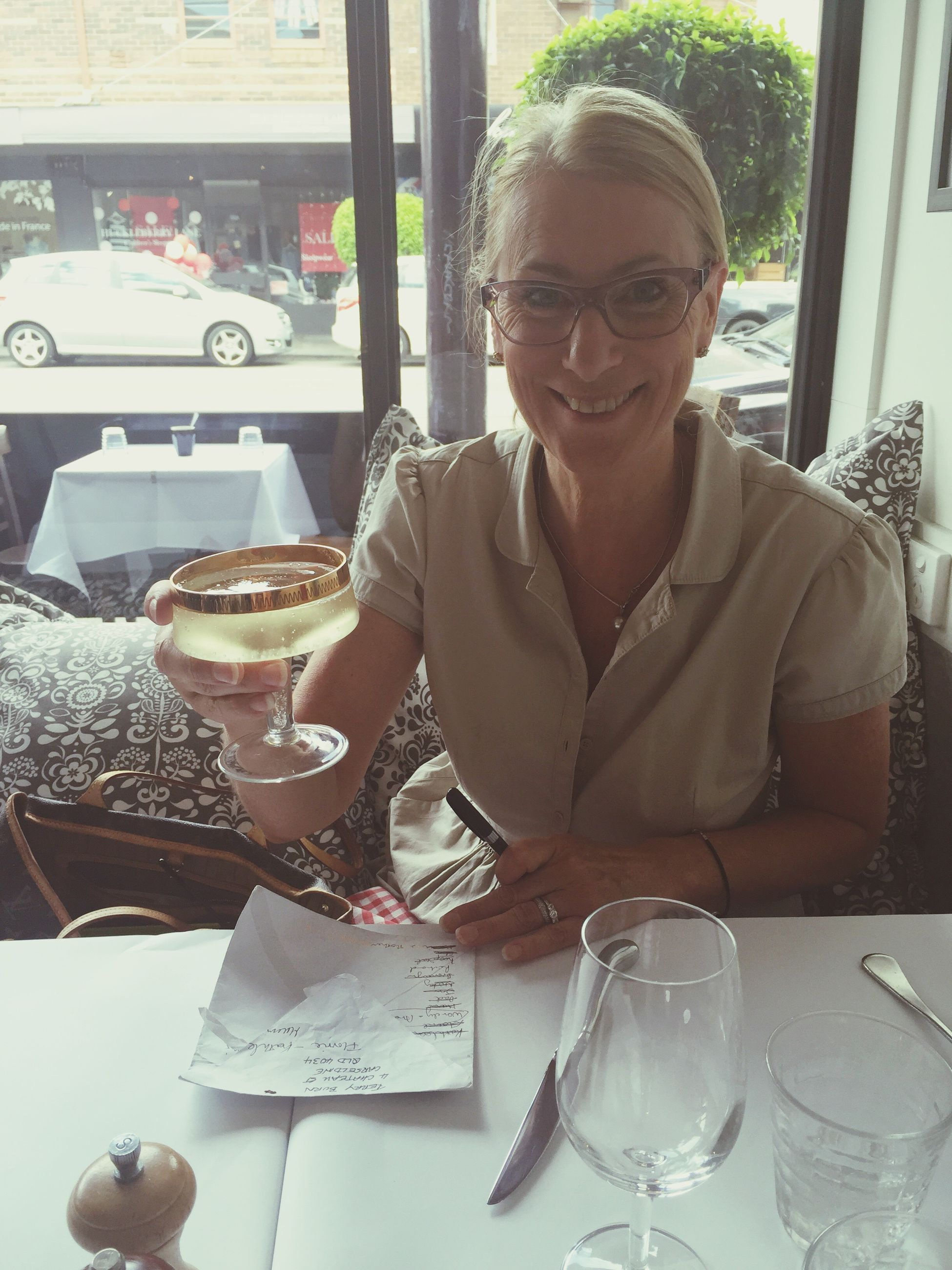 indoors, person, table, sitting, young adult, drink, restaurant, lifestyles, food and drink, leisure activity, casual clothing, refreshment, front view, looking at camera, portrait, wineglass, chair, drinking glass