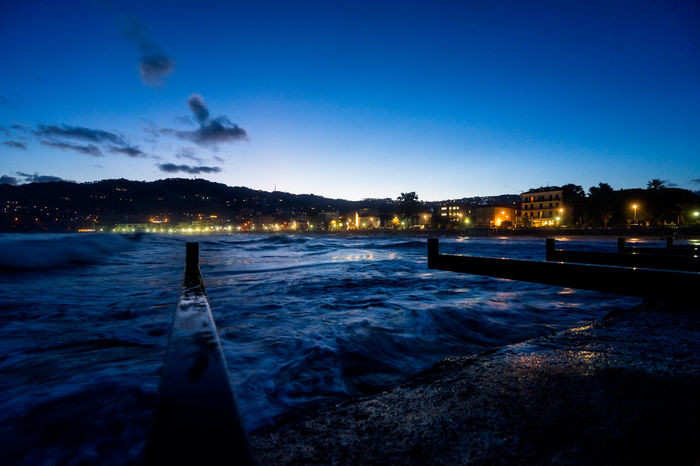 Night view at the seaport of Diano Marina Italy Harbor Pier Architecture Beauty In Nature Blue Building Exterior Built Structure Cloud - Sky Docking Illuminated Long Exposure Nature Night No People Outdoors Scenics Sky Tree Water