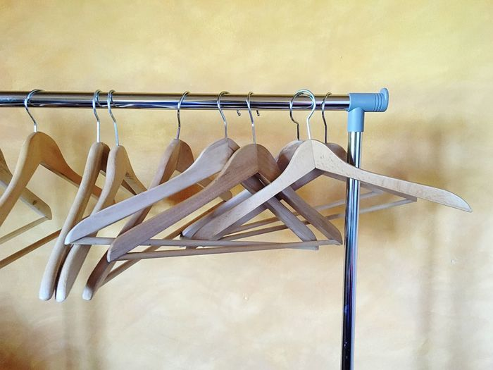 Empty clothes hanger hanging on metal pole