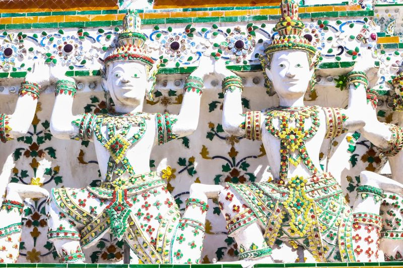 Low angle view of buddha statues for sale