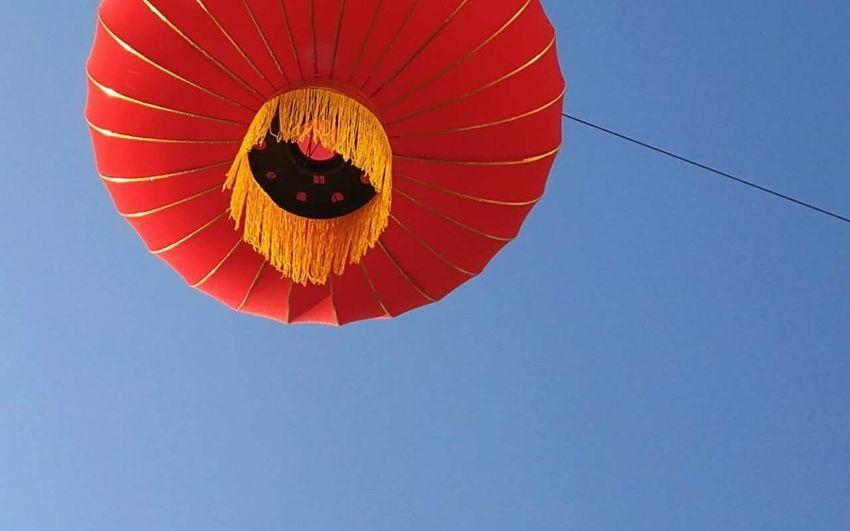 迎新春 Flying Hot Air Balloon Clear Sky Low Angle View Mid-air Blue Transportation Sky Adventure Outdoors No People Parachute Day Ballooning Festival