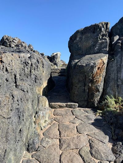 Walking Walk Travel Photography Travel Destinations Zapallar LasCujas Chile Sky Rock Land Nature Clear Sky Rock - Object Sunlight Solid Rock Formation Tranquility Day Tranquil Scene No People Blue Beauty In Nature Non-urban Scene Outdoors