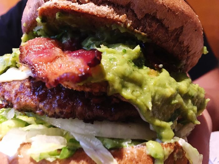 Not Mine But I Love It Anyway Burger Food Taking Photos Taking Photos From My Point Of View Showcase July Check This Out Hanging Out Good Food Explosion of food Sloppy Burger Guacamole Messy Food