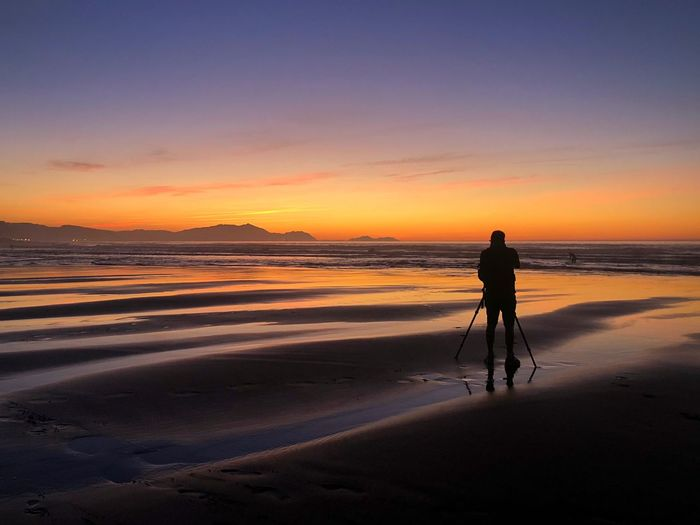 The Photographer Euskadi Silhouette Backlight Beach Photographer Human Factor Sopelana Sunset Beauty In Nature Scenics - Nature Orange Color Tranquility Men People Nature Rear View Full Length