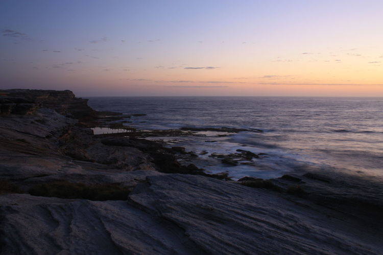 Sun rising at Maroubra Beach Beauty In Nature Clear Sky Day Horizon Over Water Long Exposure Nature No People Outdoors Rocks Scenics Sea Sky Sunrise Tranquil Scene Tranquility Water Wave